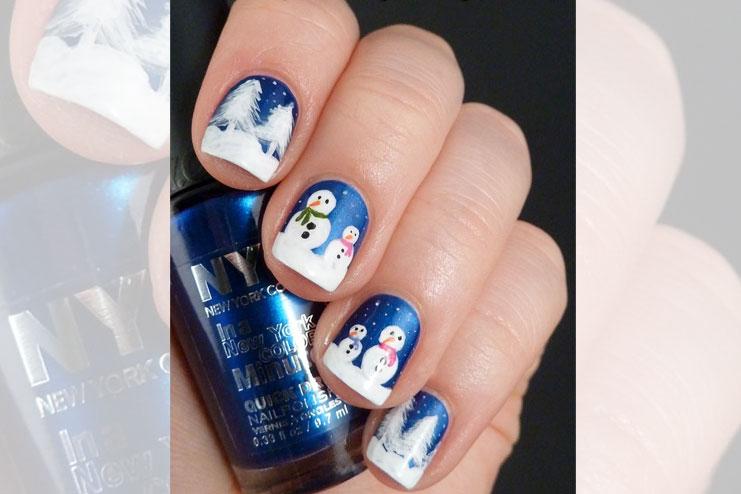A bright blue snowman Christmas nail art