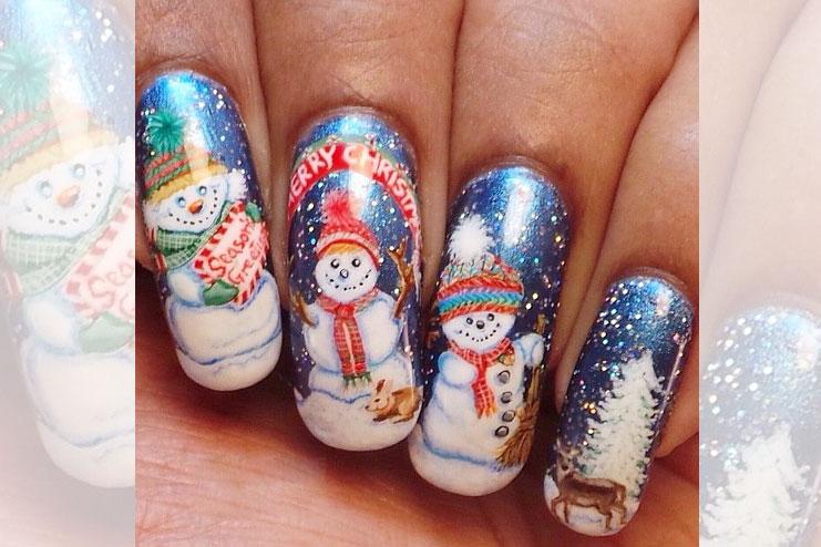 Snowman inspired nail art in elaborate