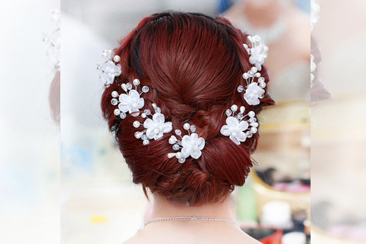 Pearl and beaded flower in crystal hair pins of brides