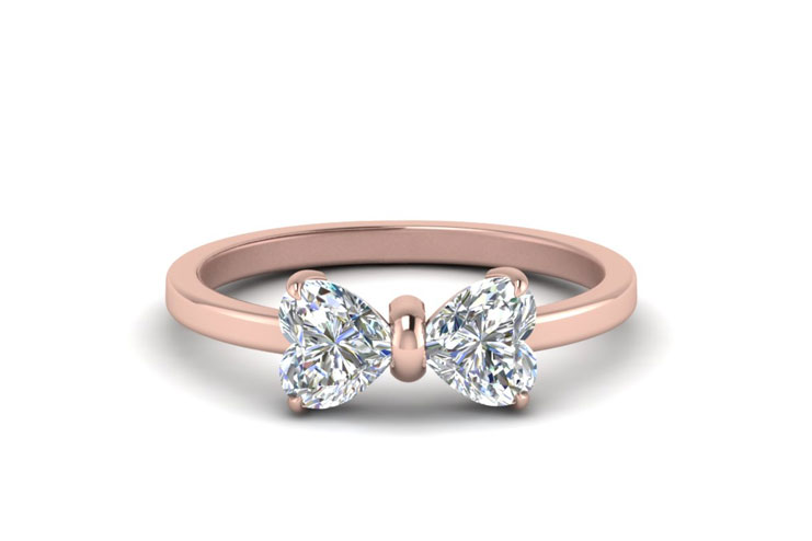 A heart into diamond shaped as a bow or a butterfly