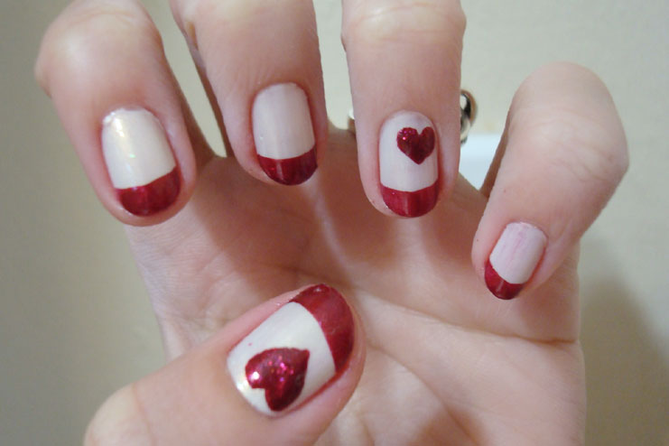 Red French tips with heart accents